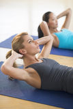 Woman Exercising With Female Friend At Gym Royalty Free Stock Photo