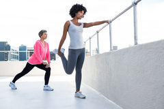 Woman exercising with female friend Stock Photos