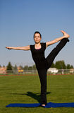 Woman exercising in field Stock Images