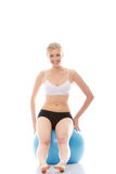 Woman exercising with fitness ball Royalty Free Stock Photography