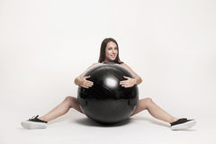 Woman exercising with fitness ball Royalty Free Stock Image