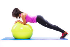 Woman exercising with a fitness ball Royalty Free Stock Image