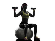 Woman exercising fitness ball weight training  silhouette Stock Image
