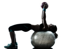 Woman exercising fitness ball workout Stock Photos