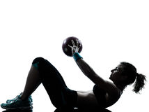 Woman exercising fitness ball workout Stock Image