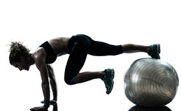Woman exercising fitness ball workout royalty free stock photography