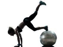 Woman exercising fitness ball workout stock photos