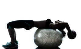 Woman exercising fitness ball workout Stock Photography