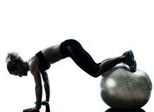 Woman exercising fitness ball workout   silhouette Royalty Free Stock Photos