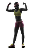 Woman exercising fitness flexing muscles  silhouette Royalty Free Stock Image