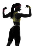 Woman exercising fitness flexing muscles silhouette rear view. One woman exercising fitness flexing muscles rear view in silhouette on white background Stock Photos