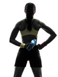 Woman exercising fitness holding energy drink  rear view silhoue Royalty Free Stock Image
