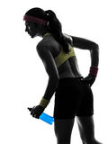 Woman exercising fitness holding energy drink  silhouette Royalty Free Stock Photo