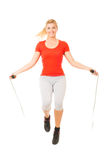 Woman exercising fitness jumping rope in Stock Image