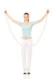 Woman exercising fitness jumping rope in Royalty Free Stock Photos