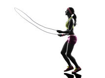 Woman exercising fitness jumping rope  silhouette. One caucasian woman exercising fitness  jumping rope  in silhouette on white background Stock Photography