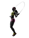Woman exercising fitness jumping rope  silhouette Stock Photos