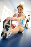 Woman exercising in fitness room Royalty Free Stock Photography