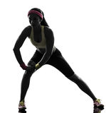 Woman exercising fitness stretching warm up silhouette Royalty Free Stock Photo