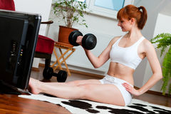 Woman is exercising with fitness video Royalty Free Stock Photo