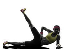 Woman exercising fitness workout  feet up silhouette Royalty Free Stock Image
