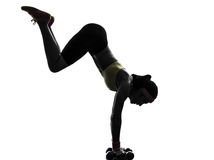 Woman exercising fitness workout handstand  silhouette Stock Image