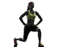 Woman exercising fitness workout  lunges crouching silhouette Royalty Free Stock Image
