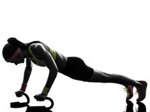 Woman exercising fitness workout push ups  silhouette Royalty Free Stock Image