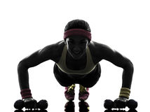 Woman exercising fitness workout push ups silhouette stock photo