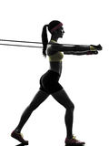 Woman exercising fitness workout resistance bands silhouette Royalty Free Stock Photos