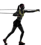Woman exercising fitness workout resistance bands silhouette Royalty Free Stock Photography