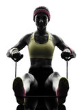 Woman exercising fitness workout resistance bands silhouette Stock Image
