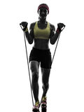 Woman exercising fitness workout resistance bands silhouette Royalty Free Stock Photo