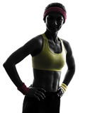 Woman exercising fitness workout  silhouette smiling portrait Royalty Free Stock Image