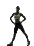 Woman exercising fitness workout standing  silhouette Royalty Free Stock Images