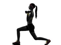 Woman exercising fitness workout  weight training silhouette Stock Photography