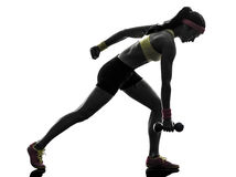 Woman exercising fitness workout weight training silhouette Stock Photo