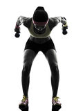 Woman exercising fitness workout weight training silhouette Royalty Free Stock Images
