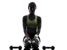 Woman exercising fitness workout weights silhouette Royalty Free Stock Photos