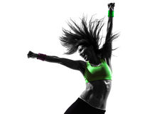 Woman exercising fitness zumba dancing silhouette. One caucasian woman exercising fitness zumba dancing in silhouette on white background royalty free stock image