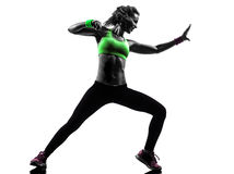 Woman exercising fitness zumba dancing silhouette. One  woman exercising fitness zumba dancing in silhouette on white background Stock Photography