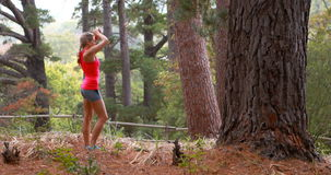 Woman exercising in forest. Beautiful woman exercising in forest, 4k stock video
