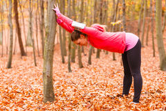 Woman exercising in the forest Stock Images