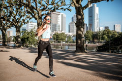 Woman exercising in Frankfurt city royalty free stock images