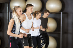 Woman Exercising With Friends In Gym Royalty Free Stock Photo