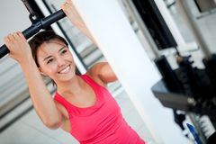 Woman exercising at the gym Royalty Free Stock Photography