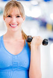Woman exercising at the gym Stock Photography