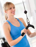 Woman exercising at the gym Stock Images