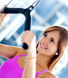 Woman exercising at the gym Royalty Free Stock Images