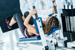 Woman exercising at the gym Royalty Free Stock Image